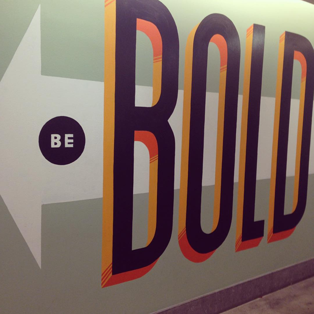 "A mural at Facebook's offices in Austin, TX encourages employees to ""Be Bold."""